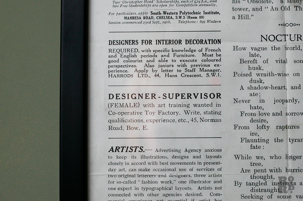Close up of framed newspaper extract showing advertisement for a female artist to work in Sylvia Pankhurst's Toy Factory in Bow East London