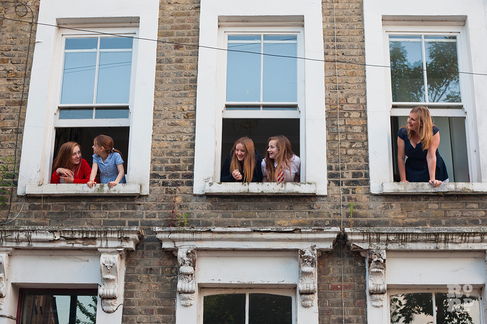 Bow resident Claire Davis and her four daughters leaning out of upstair windows