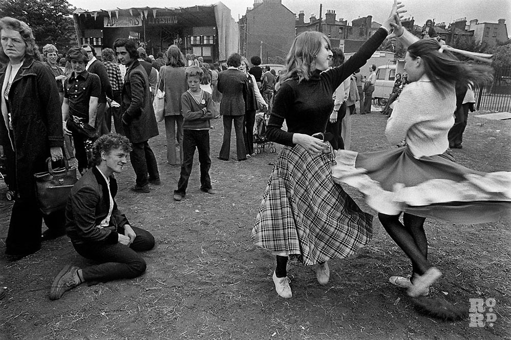 Woman dancing at festival in East London, photograph by David Hoffman.