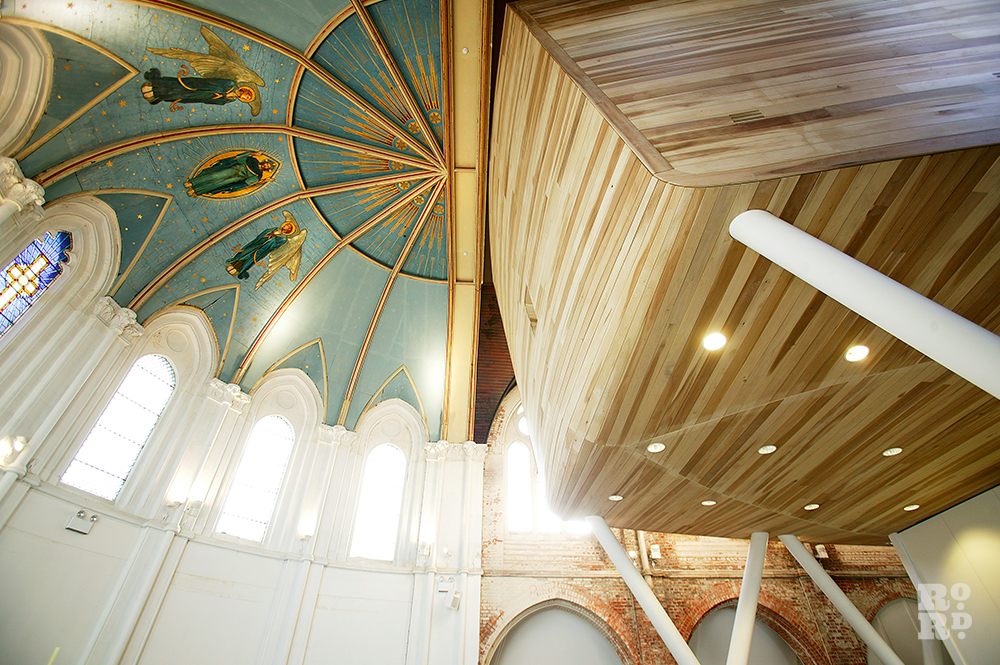 Interior of a traditioanl church with tulip wood clad cube structure