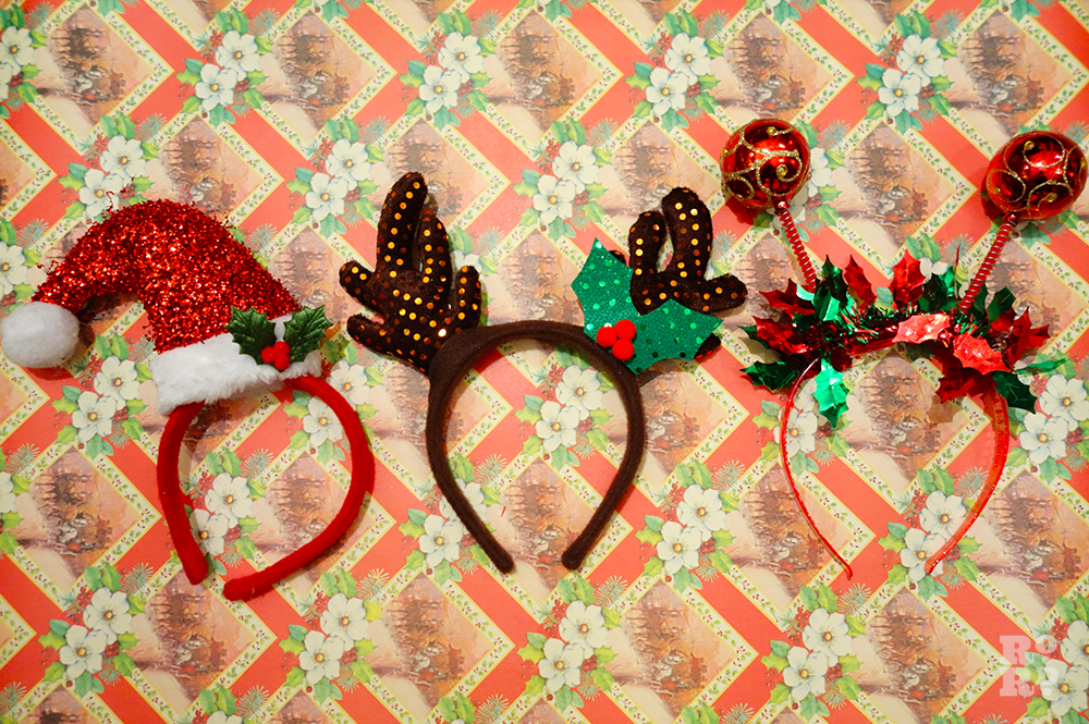 Festive hair bands decorated with santa's hat, reindeer and baubles.