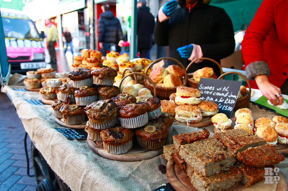 Piles of muffins at street food stall.
