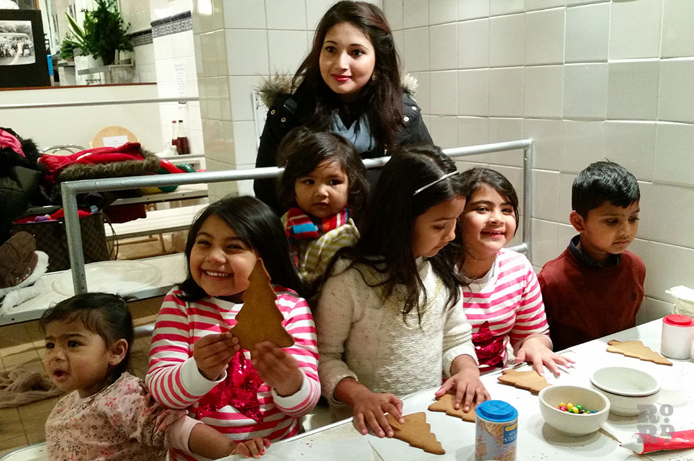 Bangladeshi children at Roman Road pie and mash shop taking part in festive biscuit decorating workshop.