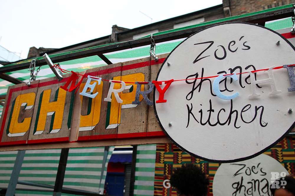 Zoe's Ghana Kitchen street food stall with garland saying Merry Christmas