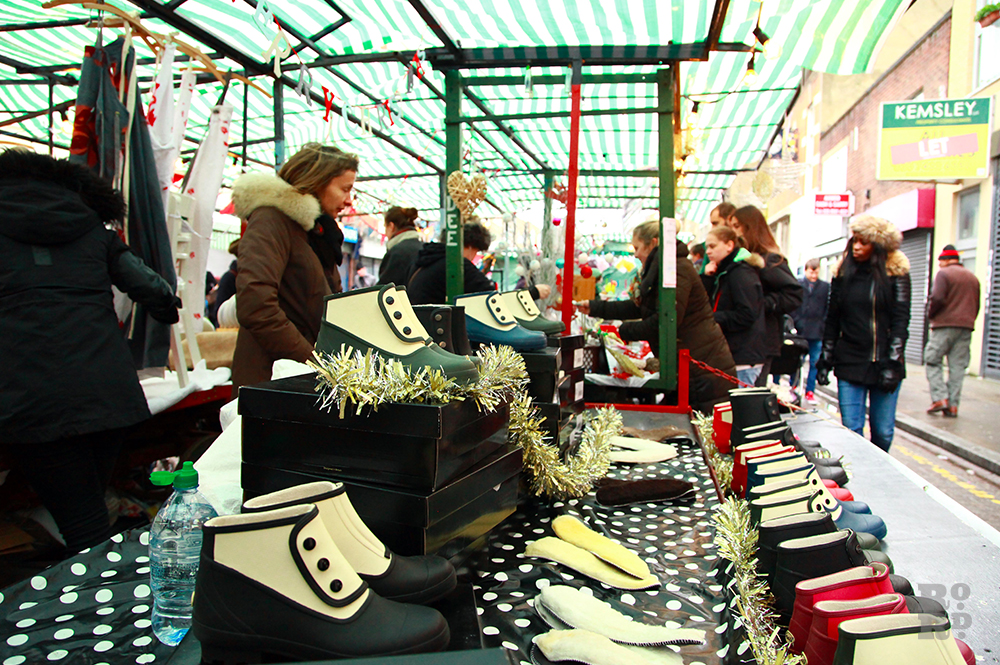 Market stall selling ankle wet weather boots.
