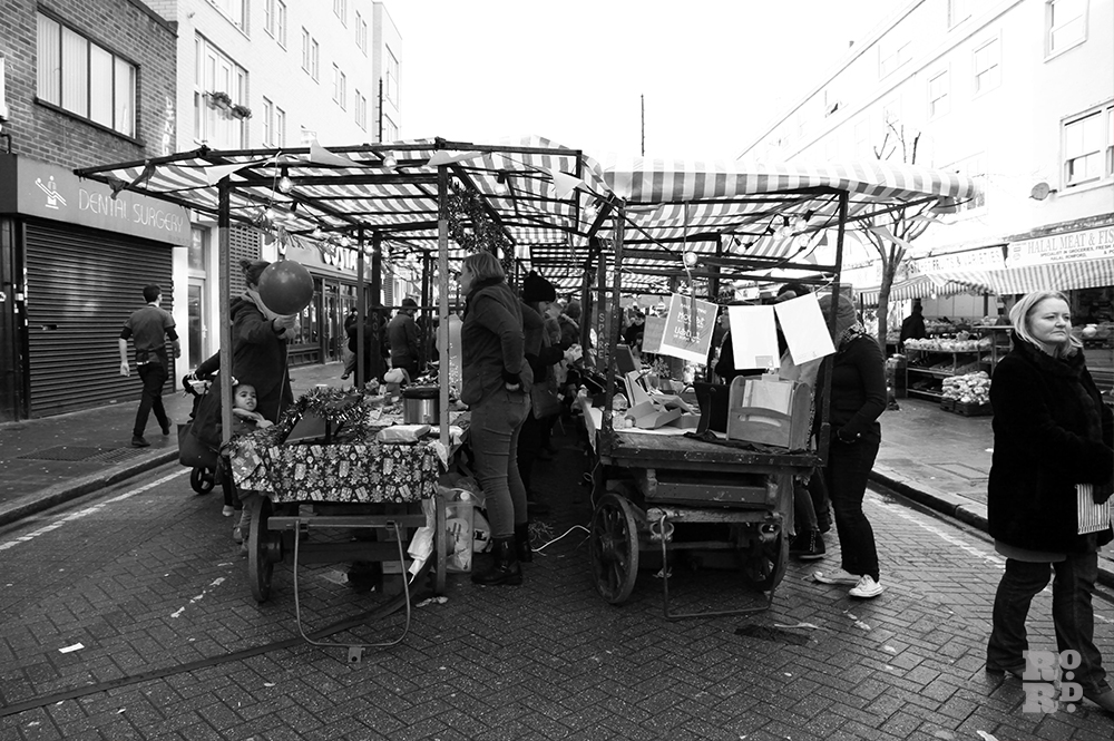 Old fashioned market stall rigs in East End Roman Road Market.