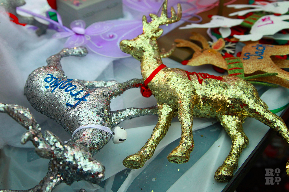 Sparkly glitter reindeer Christmas tree decorations in silver and gold.