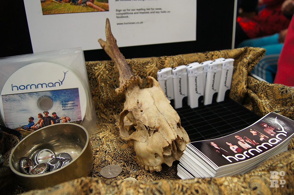 Suitcase containing sheep skull, Hornman pins, Horman CDs.