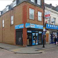 Corner shop with blue shopfront