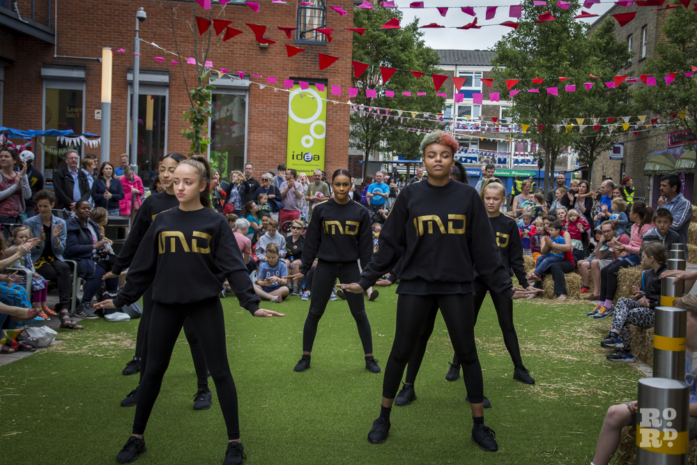 IMD Legion dance crew performing on artificial grass lawn at Roman Road Summer Festival