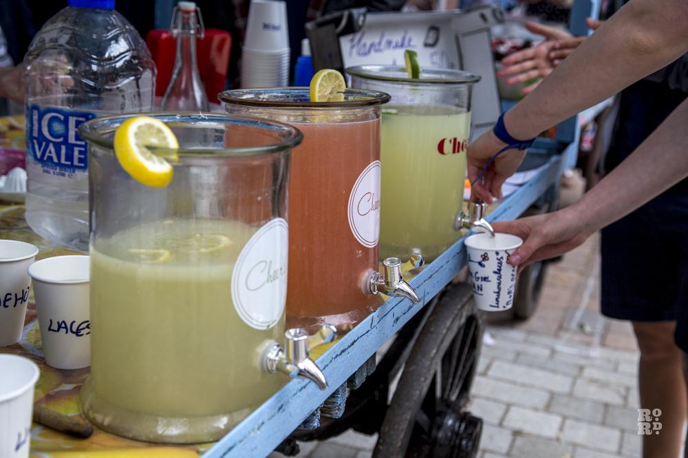 Lemonade in large drinks dispensers at festival bar