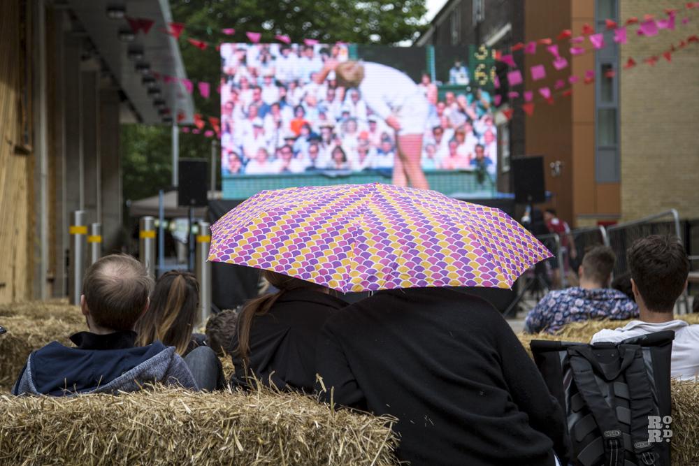 Straw bales, umbrellas, watching Wimbledon tennis on outdoor screen