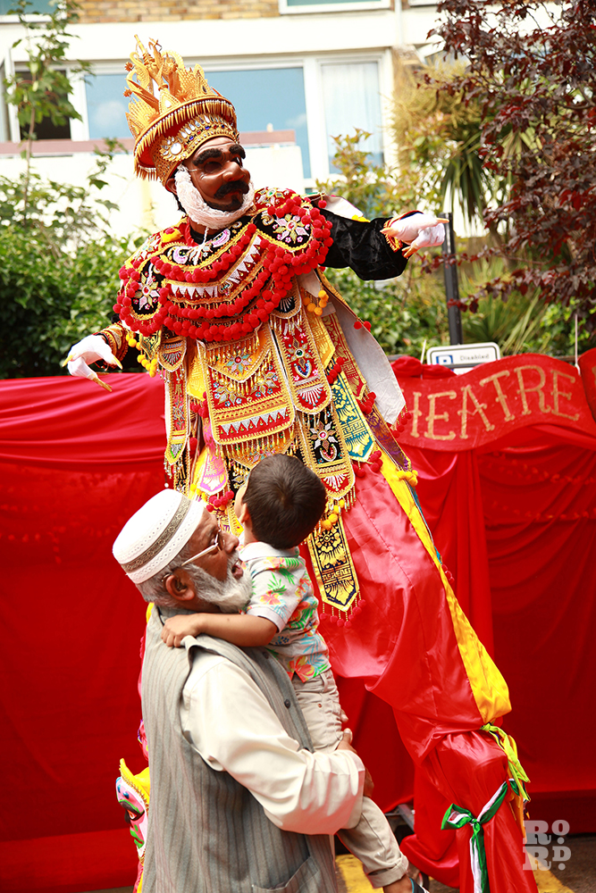 Cid Shaha stiltwalker at Teeny Tiny Theatre Roman Road Festival Eid Party
