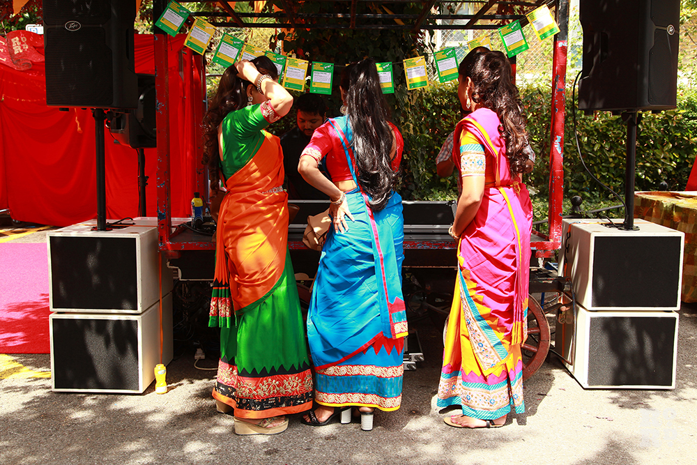 Bangladeshi dance troupe Tridhara in brightly coloured folk costumes at Roman Road Festival