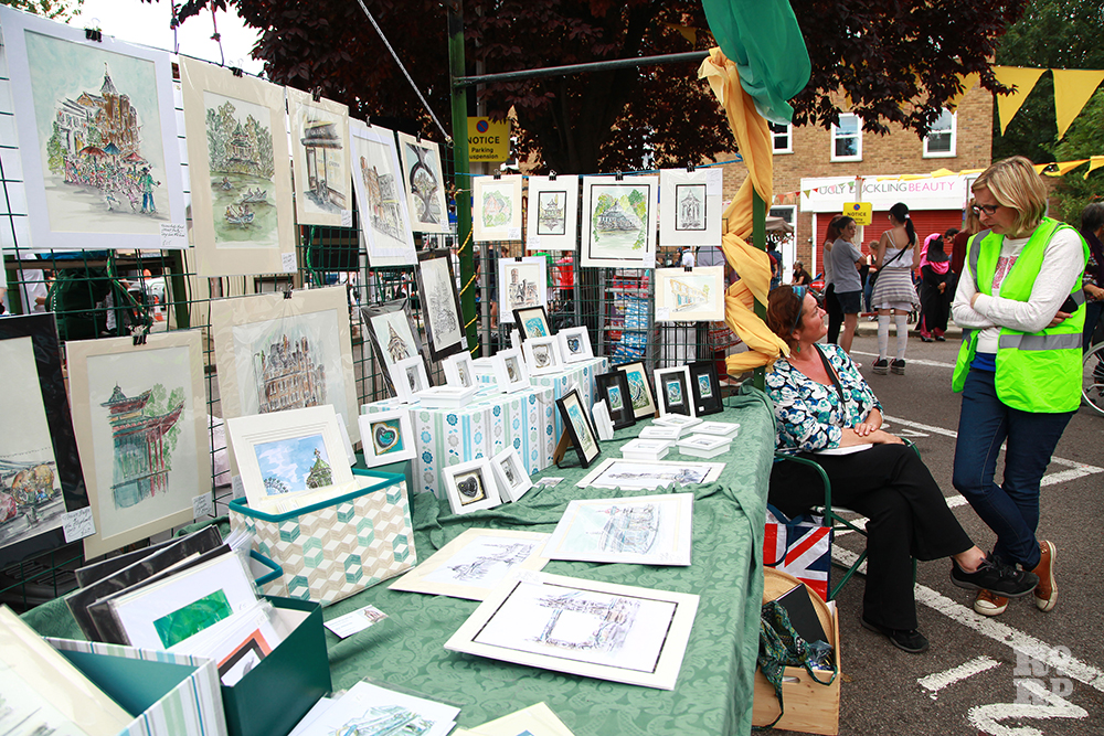Market stand selling local art and prints at Roman Road Festival
