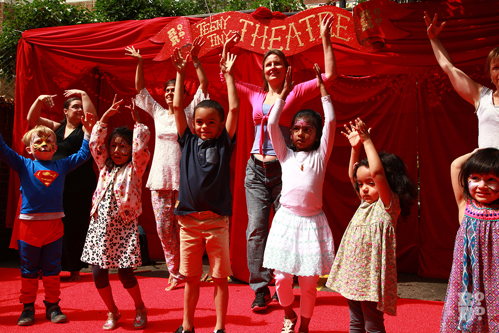 Children at the outdoor Teeny Tiny Theatre doing Bollywood moves at Roman Road Festival