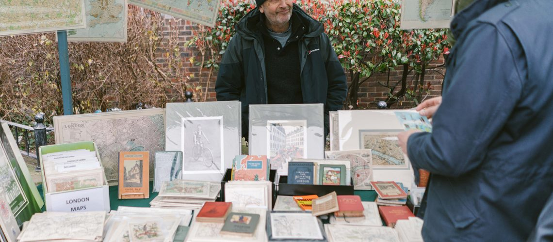 Paul from Vintage Maps selling old vintage prints, books and maps at Roman Road Yard Market launch event