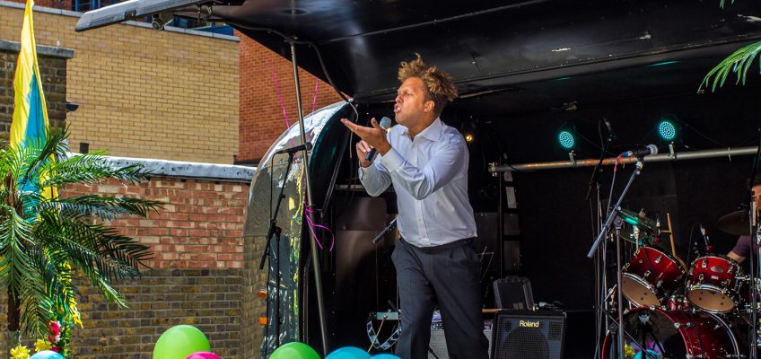 Dave Neita, People's Lawyer and People's Poet talking on Airstream stage at Roman Road Summer Festival 2016