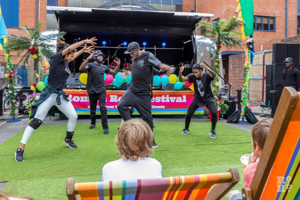 Hip hop dancers performing on artificial grass at Roman Road Summer Festival 2016