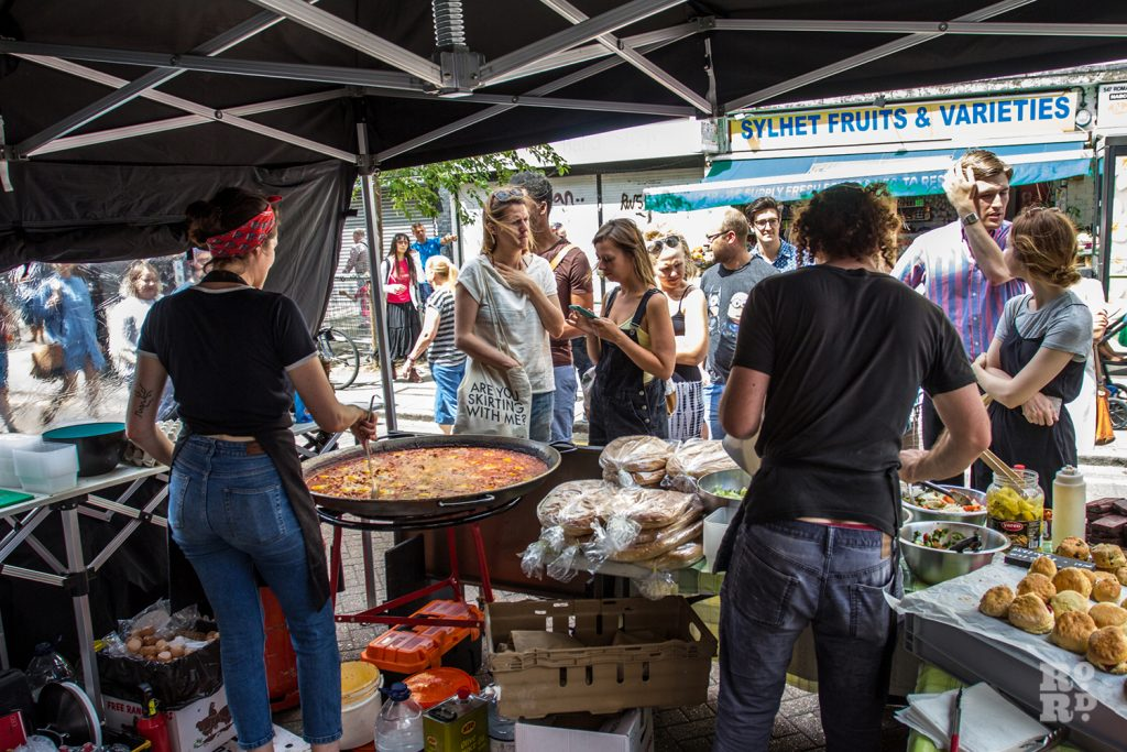 Street food trader selling food at Roman Road Summer Festival 2016