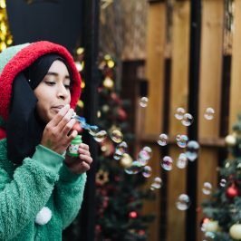 Elf blowing bubbles at Roman Road Christmas Fair 2016