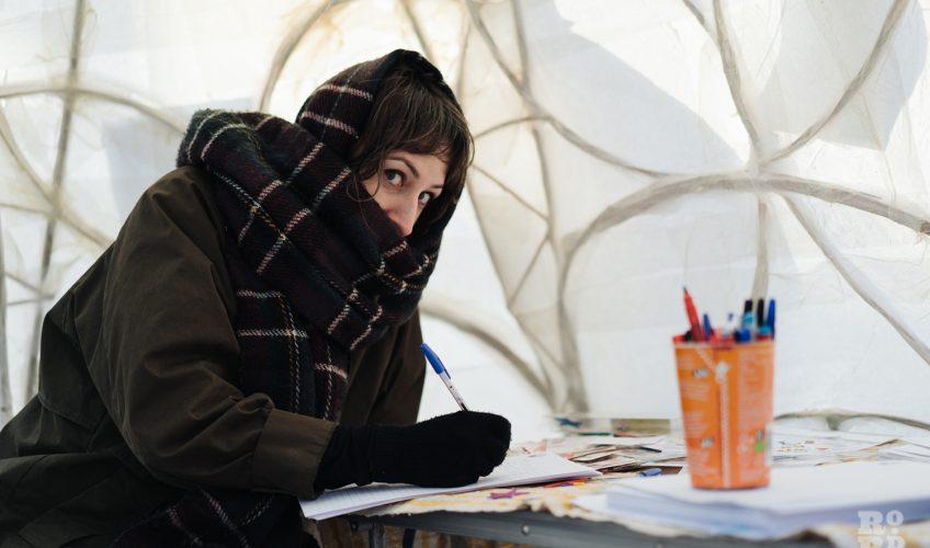 Keeping warm in the igloo at at Roman Road Christmas Fair 2016 © Roman Koblov