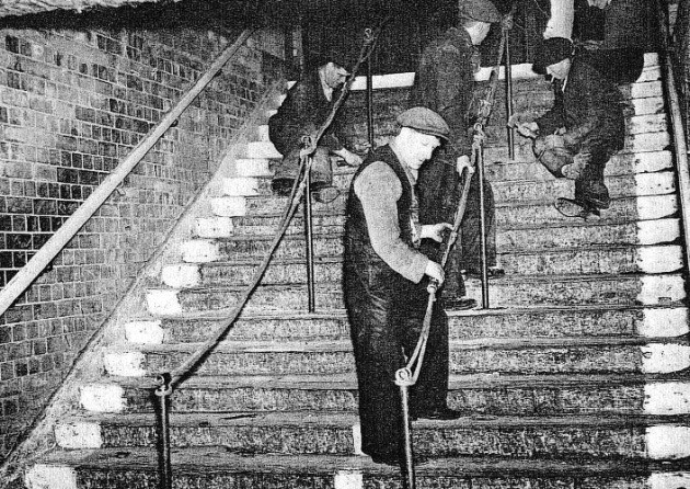 Day after Bethnal Green air-raid disaster in March, 1943, installing safety barriers at Bethnal Green Tube.