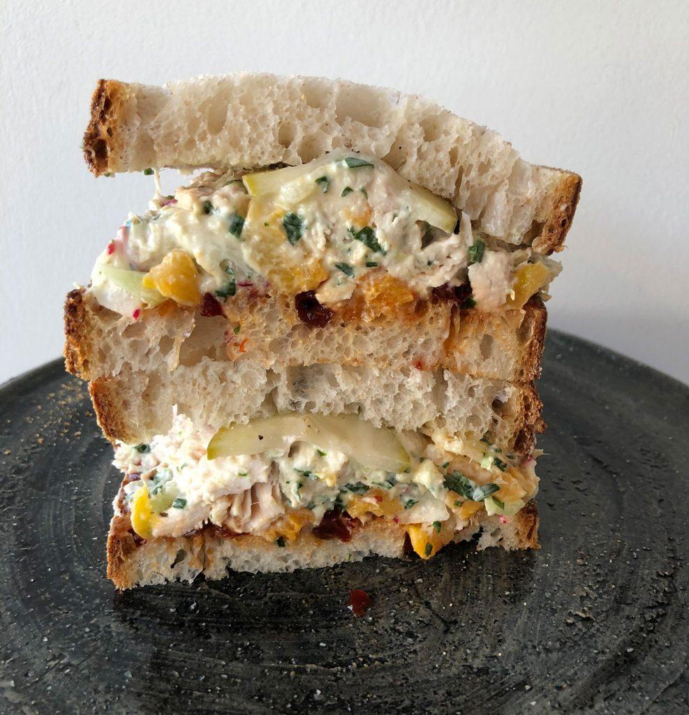 Chicken sandwich on Kana crockery.