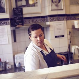 Leanne serving pie, mash and liquor at Roman Road's GKelly's pie and mash shop