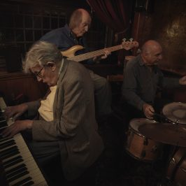 Band of crooners, piano in pub. Image from Last of the Old Crooners, Palm Tree pub by Tom Oldham