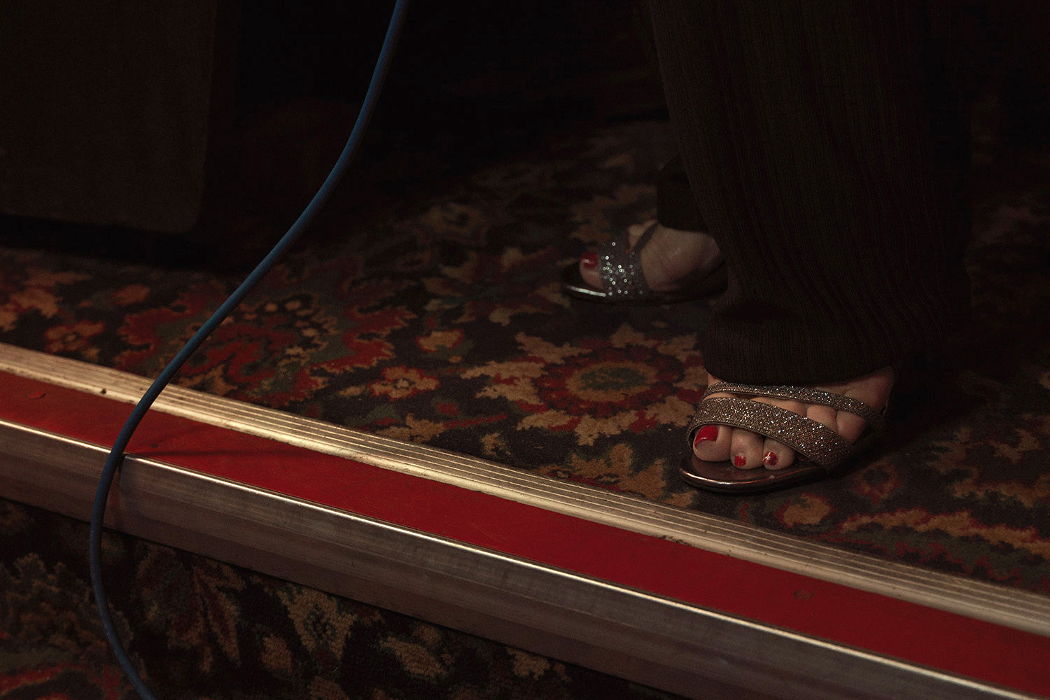 Painted toe nails, sandals, pub floor. Image from Last of the Old Crooners, Palm Tree pub by Tom Oldham