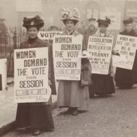 Suffragettes marching in East London