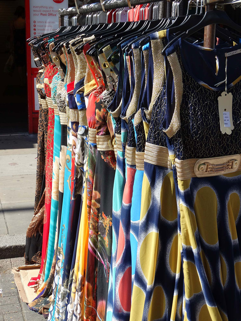 Colourful dresses for sale at Roman Road Market
