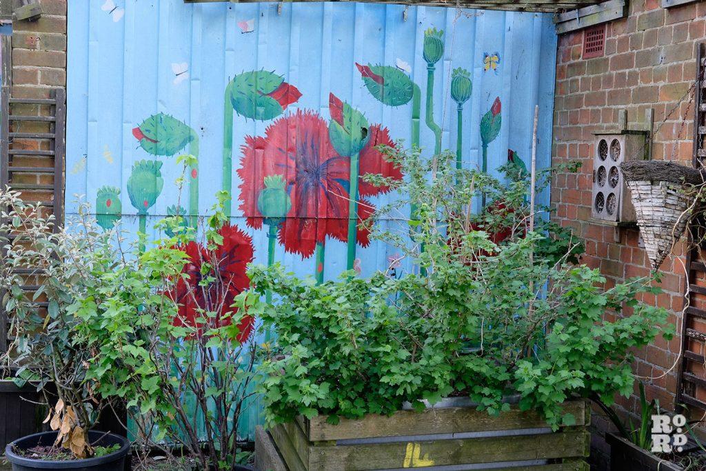 Murals on the garages at Cranbrook Community Food Garden
