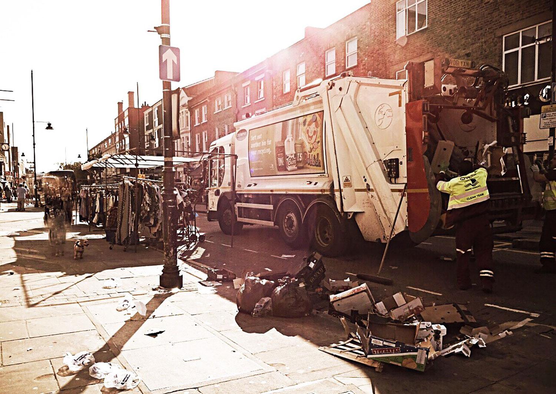 Rubbish collectors after Roman Road Market