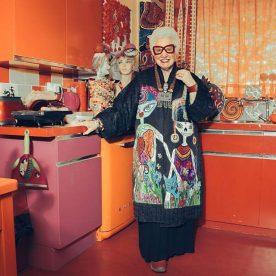 sue kreitzman standing in colourful kitchen