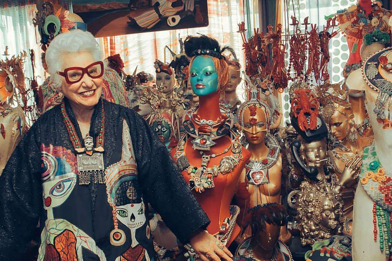 Sue Kreitzman artist with sculptures in living room
