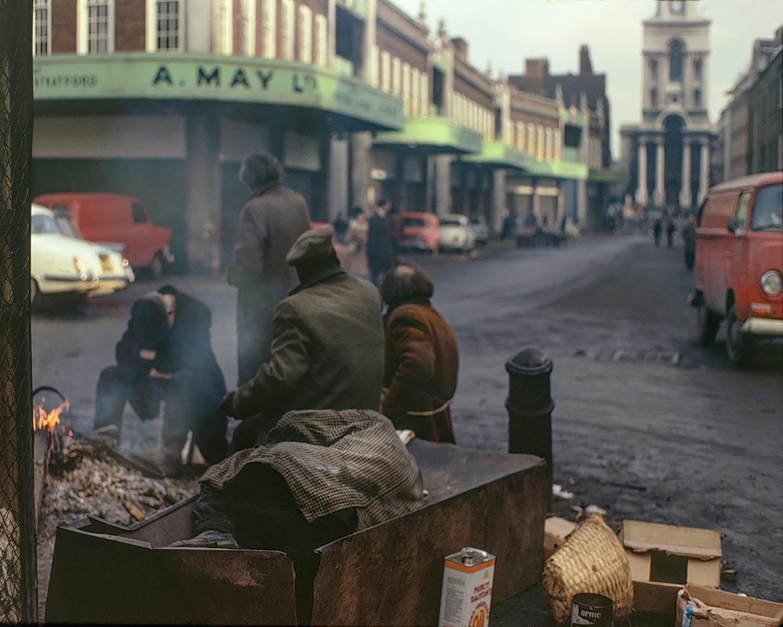 David Granick photograph of men around a fire