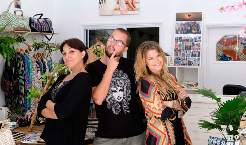 Three designers pose together in their store