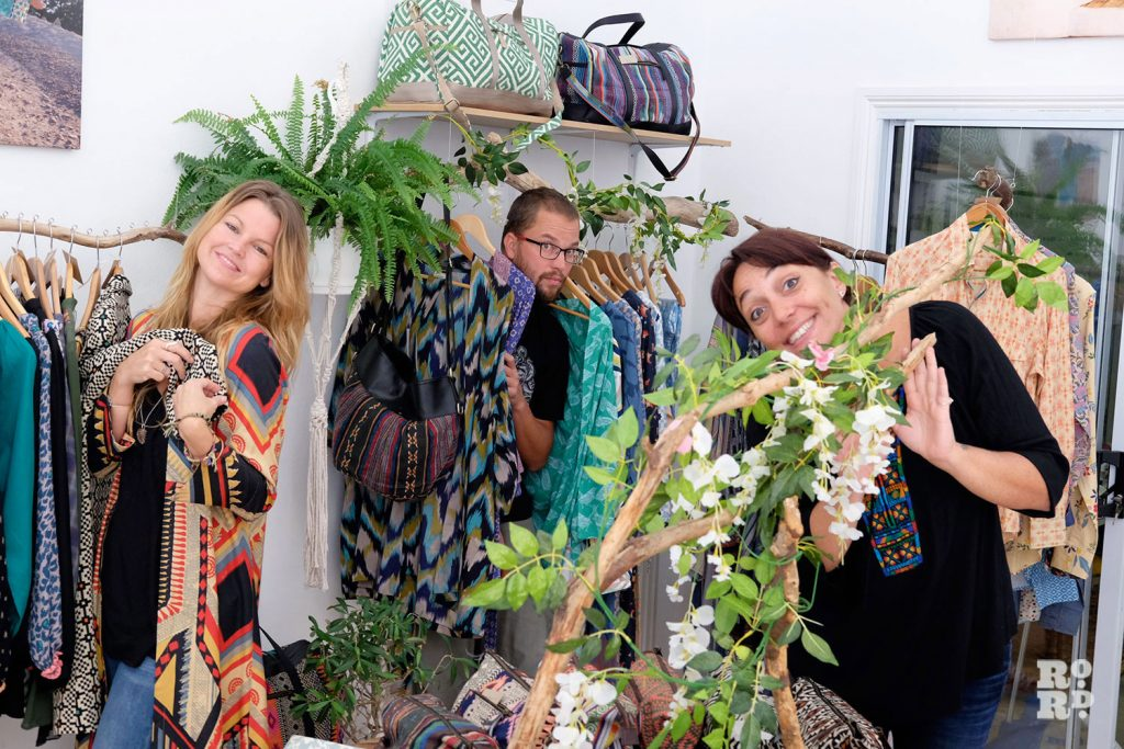The three designers of Bamboo and Bee pose with some of their products