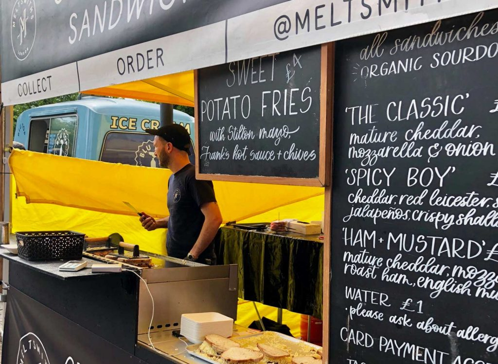 A man behind Meltsmith's stall selling toasted sandwiches
