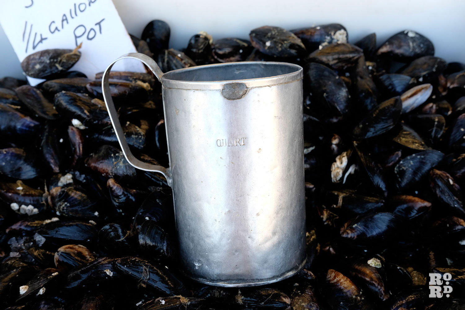 old quart cup used for measuring shellfish at East End fish stall