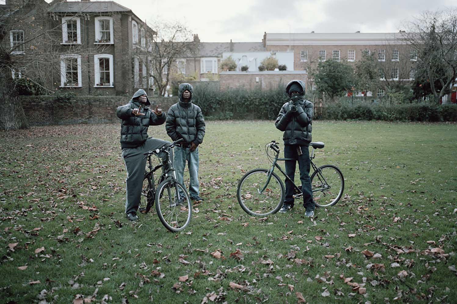 three boys with bikes