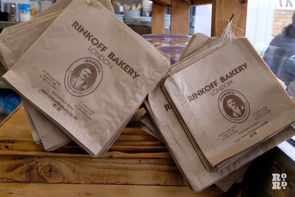 Brown paper bags hang ready for customers to use
