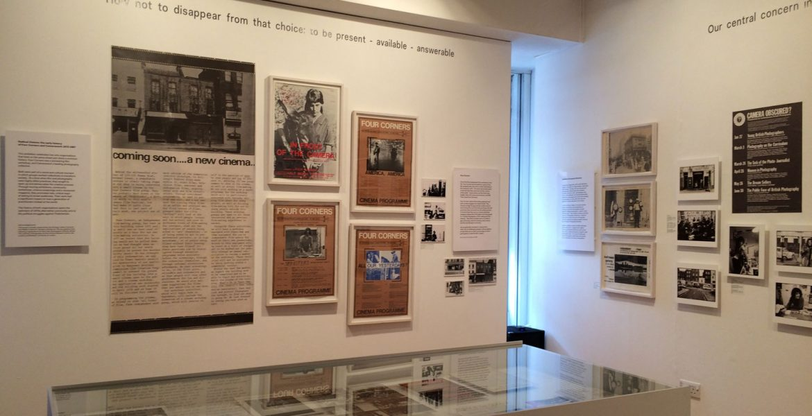 A more detailed photograph of the exhibition showing posters from a distance