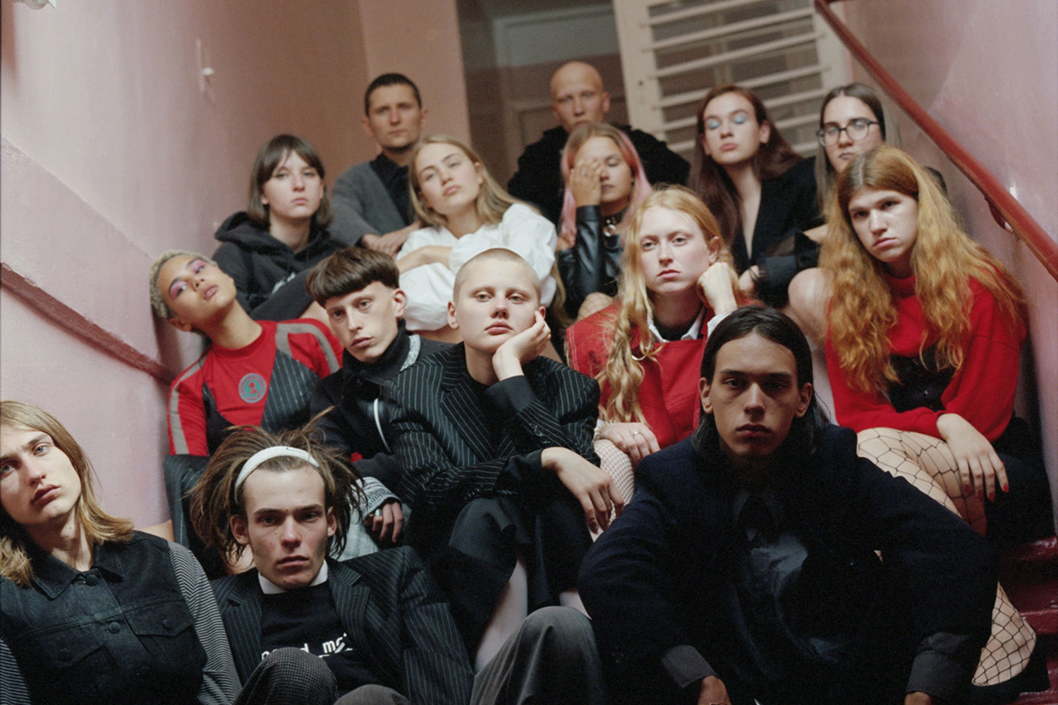 Photo of young people sitting on a staircase