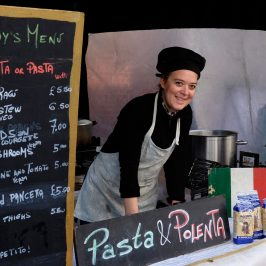 Paola welcoming customers at her stall on Roman Road Market