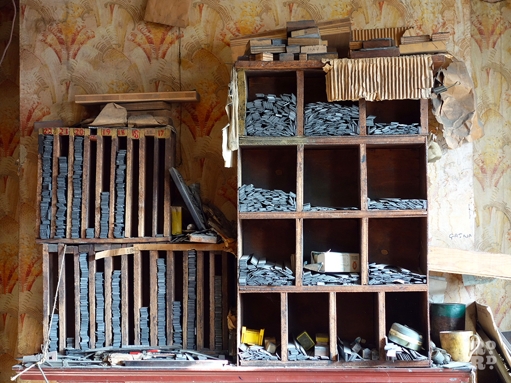 Pigeon hole cabinets filled with leads and type faces at Arbers