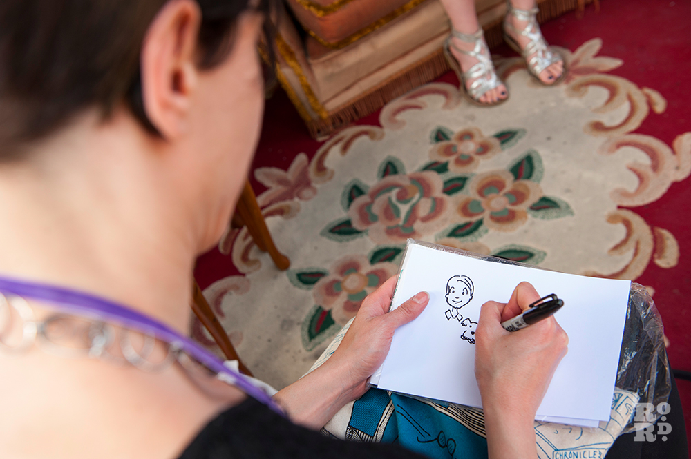 Sara Pitta sketching for Pooch Portraits at Gina's Closet for Evening Meets of Roman Road Festival