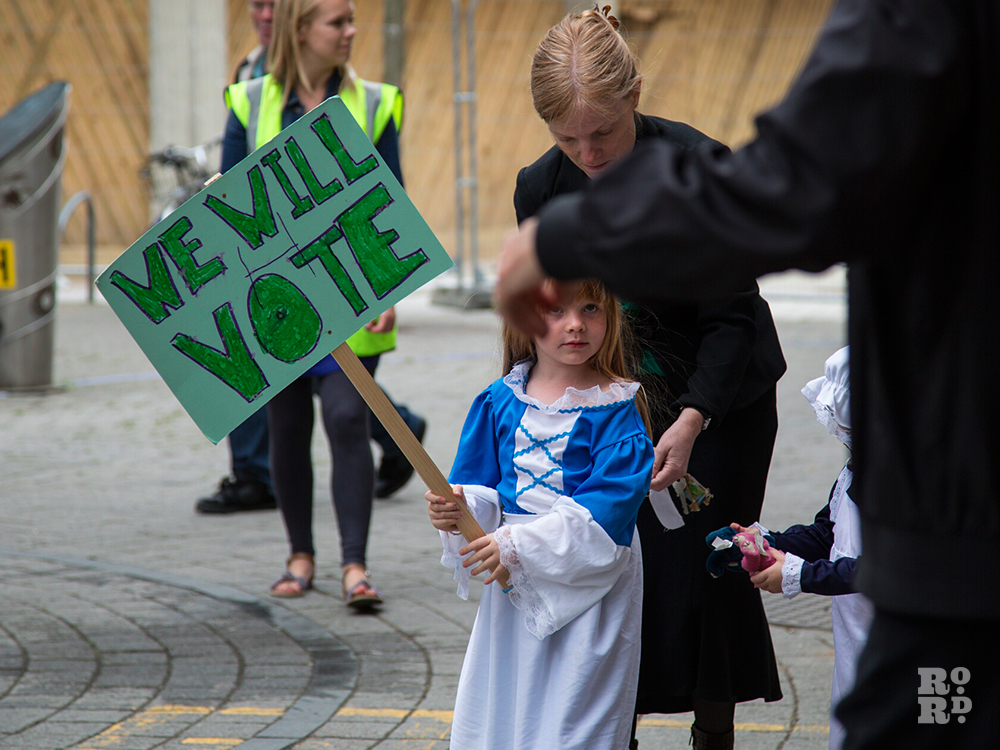 Young Suffragette with We Will Vote placard